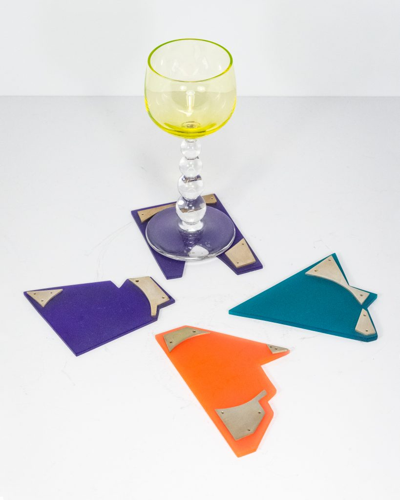 Drink Coasters.Rivoted Sterling Silver and Plexi.Varying sizes between 2.5_ to 5_.$3500. for set of 4
